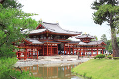 Byodo-in Buddhist temple. June 20, 2015: The famous Byodo-in Buddhist temple a UNESCO World Heritage Site. Phoenix Hall building in Uji city Royalty Free Stock Photos