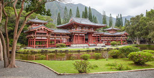 Byodo-In Buddhist Temple. Located on Oahu's Windward side, sits amidst lush greenery and against a beautiful misty mountain backdrop Stock Photos