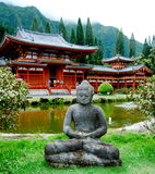 Byodo-In Temple with Statue. Replica of temple in Japan, the Byodo-In Temple is a non-denominational temple located on the island of Oahu in Hawaii at the Valley stock image