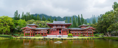 Byodo-In Temple, Valley of the Temples, Hawaii. Panorama Byodo-In Temple with the Koolau mountains in the Valley of the Temples on Oahu, Hawaii against a foggy Stock Photo
