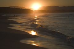 Byron Strand-Sonnenuntergang Stockfotografie