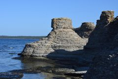 Byrum`s raukar at the island Oland. With limestone coast royalty free stock photos