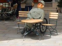 Bystander - Karlovy Vary, Czech Republic. Uniformed bystander at café table Karlovy Vary, Czech Republic Stock Photo