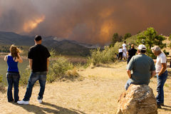 Bystanders at the High Park Fire, Ft.Collins Co. Several people stop to watch the recent forest fire in Fort Collins Colorado.  The fire is burning over 37,000 Royalty Free Stock Images