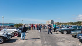 Bystanders watching old cars Royalty Free Stock Images