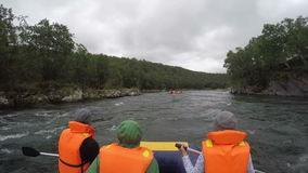 Summer rafting on Kamchatka Peninsula in gloomy cloudy weather stock video footage