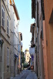 Bystreet of the old town in  Saint-Tropez. Sale of paintings on the bystreet of the old town in  Saint-Tropez Stock Image