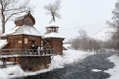 Bystrinsky Ethnographic Museum. Kamchatka Krai, Esso Village. ESSO VILLAGE, KAMCHATKA PENINSULA, RUSSIA - MARCH 09, 2013: Winter view of the wooden building Stock Image