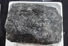 Bytounite grabbro intrusive igneous rocks. Intrusive igneous rocks. Geological collection in Colombia for geologists. Study of soils, minerals and rocks. Sample Stock Images