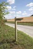 A byway signpost in English countryside. A Byway wooden sign on a country road in southern England UK Byway may be used by walkers and horse riders Royalty Free Stock Photo