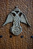 Byzantine Church Emblem at wooden door. Byzantine orthodox church emblem, double-headed eagle, done like wooden reilef Stock Images