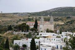 Byzantine church greek islands paros. The byzantine church of agia triada in lefkes paros cyclades in the greek islands with flag of greece Stock Images