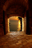 Byzantine door. Sunset through the old byzantine door on Mount Athos, Greece royalty free stock images