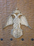 Byzantine double headed eagle insignia. Greek Orthodox Church insignia, byzantine double headed eagle, on wooden door Stock Photos
