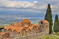 Byzantine monastery buildings in Mystras Peloponnese Greece. Monastery buildings in the medieval Byzantine ghost town-castle of Mystras, Peloponnese, Greece royalty free stock image