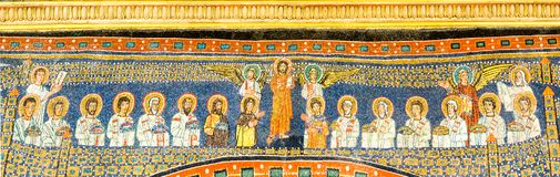 Byzantine mosaic. Angels and saints gathering around christ. Angels and saints gathering around christ in heaven. A mosaic in the basilica of Santa Prudence royalty free stock photo