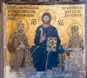 Byzantine mosaic of Jesus Christ on throne with Empress Zoe and Emperor Constantine IX Monomachus in Hagia Sophia Istanbul, stock image