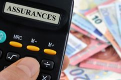 Cálculo del coste de seguro foto de archivo libre de regalías