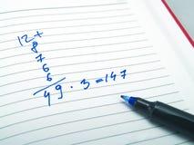Cálculo en una agenda Imagen de archivo