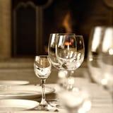 Cálices de vidro na tabela Fotos de Stock Royalty Free