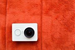 Cámara blanca de la acción con una lente grande Fotografía de archivo libre de regalías
