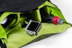 cámara de la acción en caso impermeable y pequeño trípode Imágenes de archivo libres de regalías
