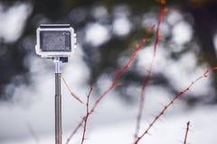 Cámara de la acción en nieve actioncapturing fotos de archivo
