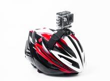 cámara de la acción fijada en casco de la bici Imagen de archivo libre de regalías