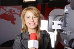 Cámara de vídeo del reportero del informativo de televisión y Imagen de archivo