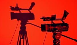 Cámara de vídeo en sombra del negro vith imagen de archivo libre de regalías