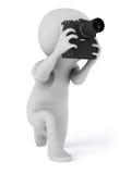 Cámara del fotógrafo que toma las fotografías Foto de archivo libre de regalías