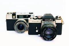 Cámara del vintage Minolta XE-5 y de Taron Foto de archivo libre de regalías