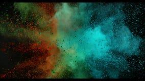 Cámara lenta estupenda de la explosión coloreada del polvo aislada en fondo negro libre illustration