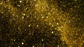 Cámara lenta estupenda de partículas de oro que brillan en fondo negro almacen de video