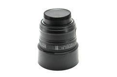 Cámara negra de la lente aislada en el fondo blanco fotos de archivo libres de regalías