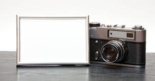 Cámara y foto del vintage Fotografía de archivo libre de regalías