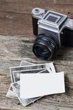 Cámara y fotos de la foto del vintage Foto de archivo