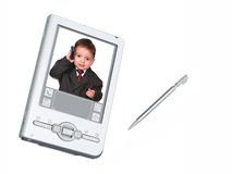 Cámaras digitales PDA y aguja sobre blanco con el niño en el teléfono fotografía de archivo