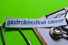 Cáncer gastrointestinal en concepto de la atención sanitaria con el fondo verde imagen de archivo