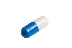 Cápsula azul e branca isolada no branco Foto de Stock