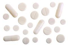 Cápsula branca do comprimido isolada no fundo branco Vista superior Configuração lisa Fotografia de Stock Royalty Free