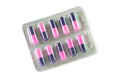Cápsula de la medicina en paquete de ampolla Imágenes de archivo libres de regalías