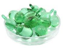 Cápsula del suero de la vitamina del pelo en envase Foto de archivo libre de regalías