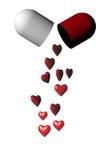 Cápsula médica de la píldora con los corazones rojos Fotos de archivo libres de regalías
