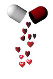 Cápsula médica do comprimido com corações vermelhos Fotos de Stock Royalty Free
