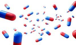 Cápsula medicinal em um fundo branco Fotografia de Stock Royalty Free