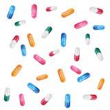 Cápsula transparente colorida de queda com grânulo Fotos de Stock
