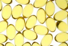 Cápsulas amarelas Imagem de Stock