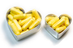 Cápsulas amarillas del supplemnet CoQ10 (coenzima Q10) de la comida Foto de archivo