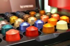 Cápsulas coloridas do café Fotos de Stock Royalty Free